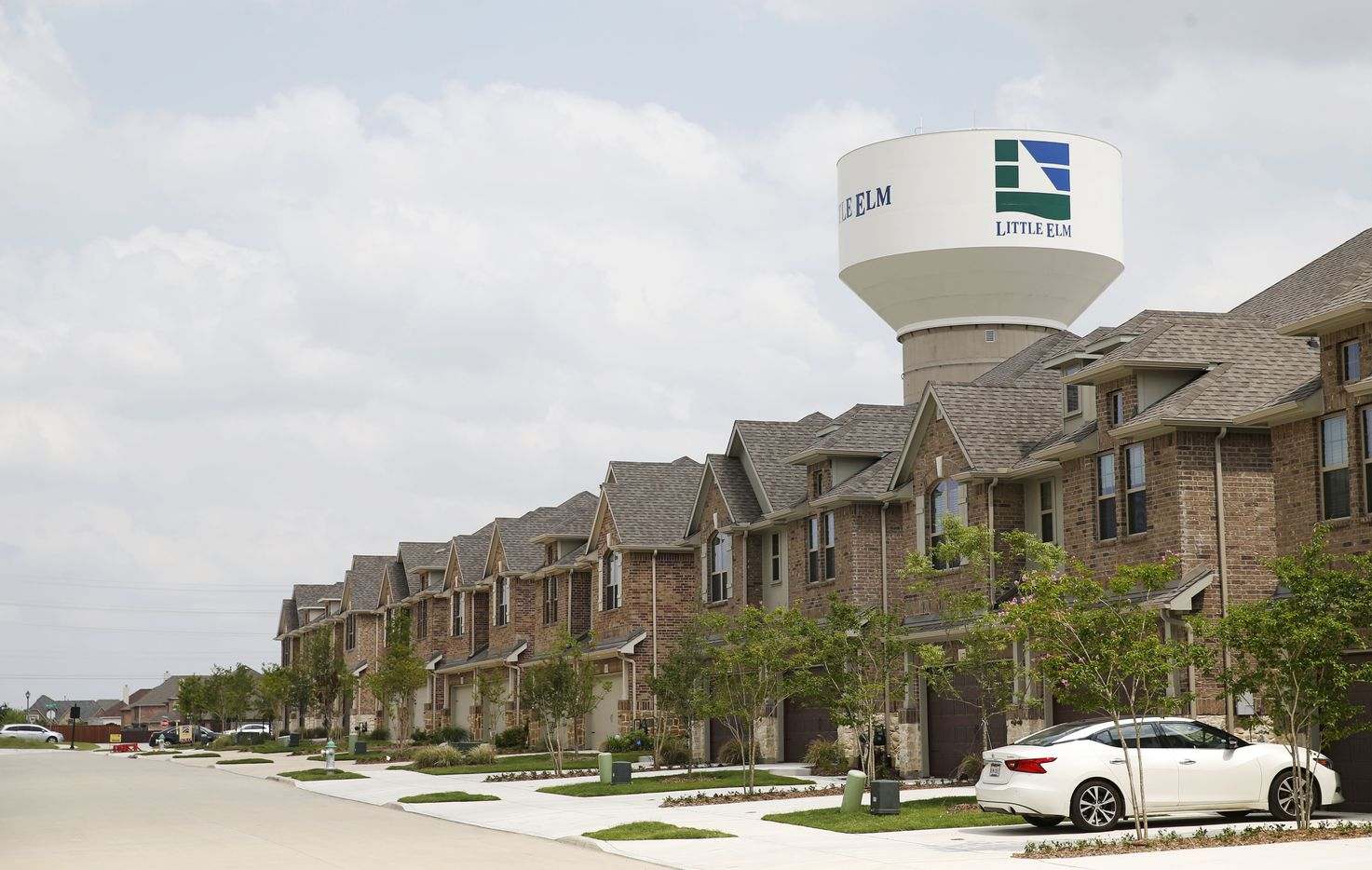 Townhomes in Little Elm, Texas on Wednesday, May 22, 2019. Little Elm, which had just 3,500 people as of the 2000 Census, surpassed 50,000 residents in 2018. (Vernon Bryant/The Dallas Morning News)