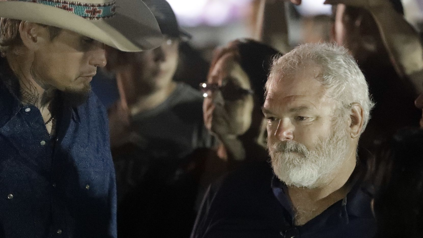 Stephen Willeford, right and Johnnie Langendorff, left, attend a vigil for the victims of the First Baptist Church shooting Monday, Nov. 6, 2017, in Sutherland Springs, Texas.