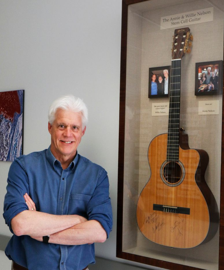 Olson displays a guitar in his lab area that was given to him by his friend Willie Nelson.