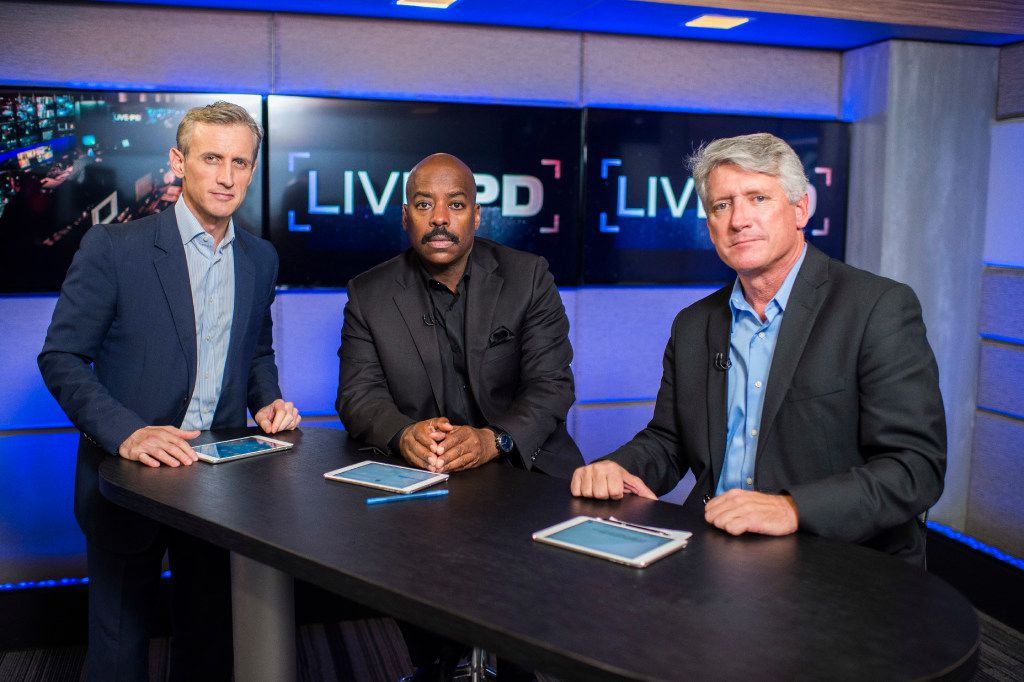 Host Dan Abrams (left to right) is joined by Dallas police Detectives Rich Emberlin and Kevin Jackson on Live PD.