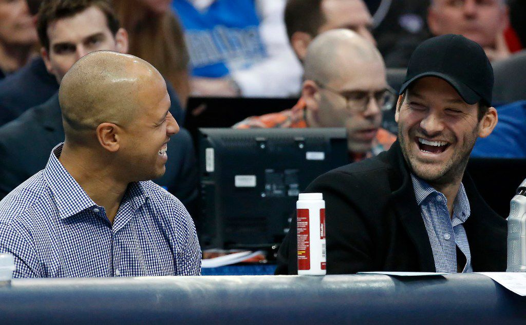 Tony Romo (right) shares a laugh with Miles Austin during the second quarter of the Dallas Mavericks and New York Knicks game at American Airlines Center in Dallas, Wednesday, Jan. 25, 2017. (Jae S. Lee/The Dallas Morning News)