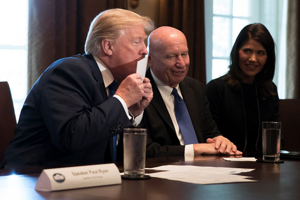 "President Donald Trump kisses a  ""postcard"" tax return, part of the outline of the Republicans' just-released tax proposals, at the White House in Washington on Nov. 2, 2017. House Republican lawmakers outlined a $1.51 trillion tax plan that would deliver a significant tax cut for corporations. Looking on are Rep. Kevin Brady, R-Texas, and Rep. Kristi Noem, R-S.D."
