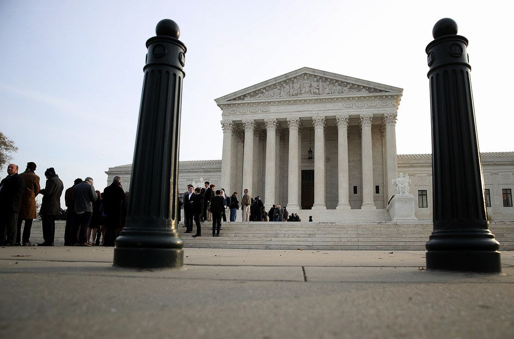 Crowds lined up outside the U.S. Supreme Court to attend the day's session on Dec. 4, 2017.