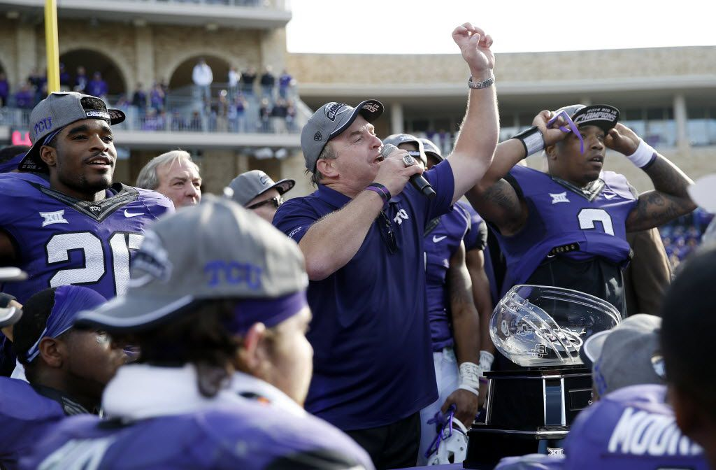 FILE - TCU head coach Gary Patterson congratulates fans during a trophy presentation after earning a share in the Big 12 championship title during an NCAA college football game between Iowa State and TCU at Amon G. Carter Stadium in Fort Worth December 6, 2014. TCU beat Iowa State 55-3, which earn the Horned Frogs a share in the Big 12 championship title. (Andy Jacobsohn/The Dallas Morning News)