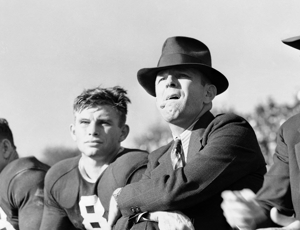 ORG XMIT: APHS142910 Coach Dutch Meyer of Texas Christian University, right, continued an old custom of sticking his tongue out at the TCU-Rice Game in Fort Worth, Tex., Nov. 19, 1939. The worried look and alfresco tongue go together whenever Meyer's ace passer and field general, Davey O'Brien, is out of a game. That happens to be O'Brien alongside the coach. TCU won. (AP Photo) 12052010xSUPERBOWLXLVKICKOFFmagazine