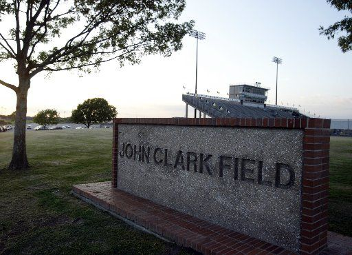 A marker in front of the football stadium at John Clark Field in Plano. A new sign on the back of the press box uses the word stadium instead of field.