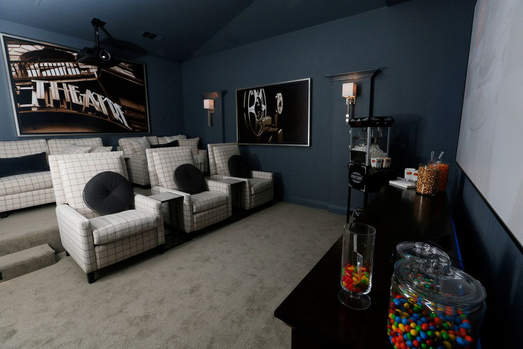 The theater room inside HGTV's Smart Home in Roanoke has three recliners and two loveseats.