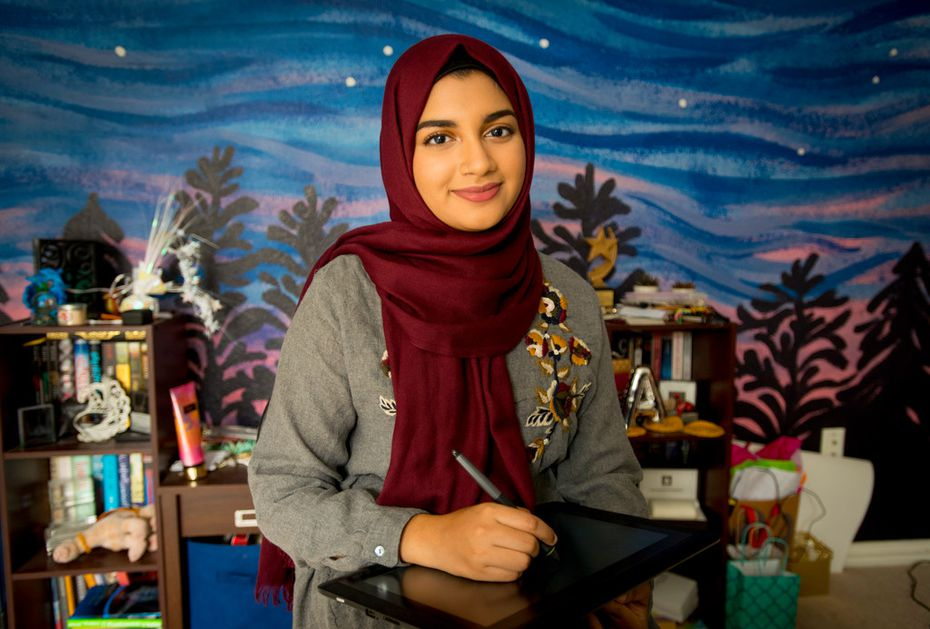Aaliya Jaleel at home in Richardson, in front of the mural she painted on her wall.