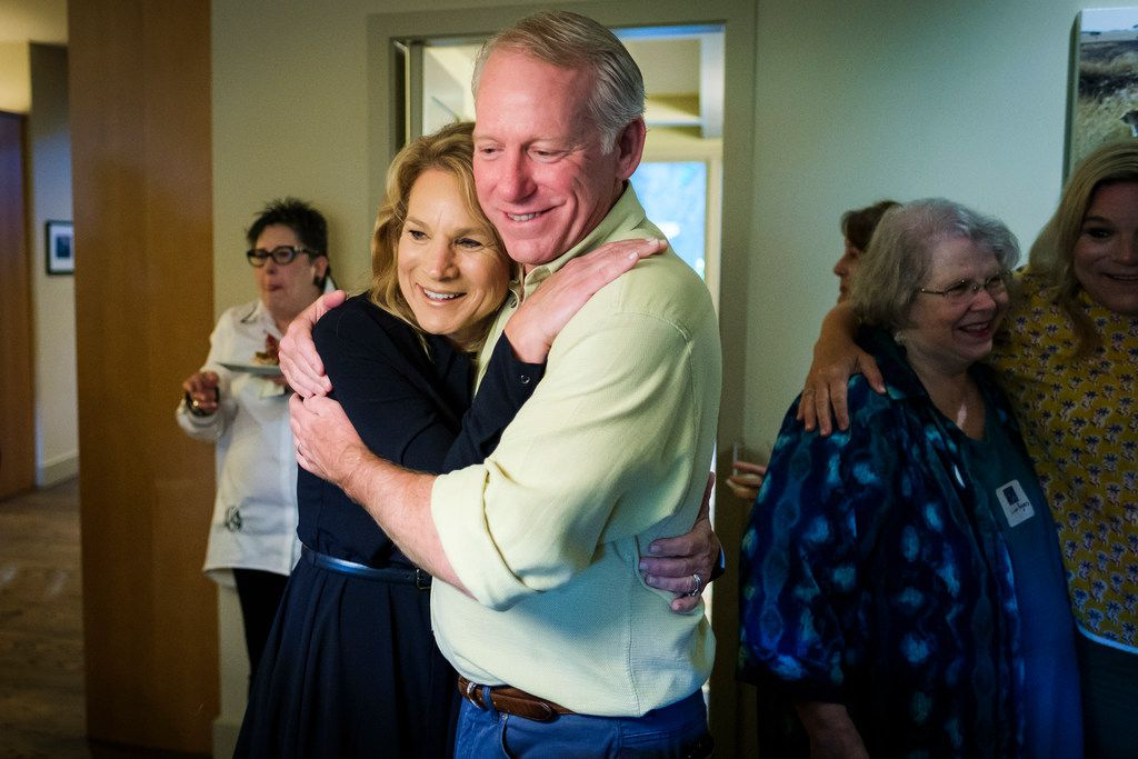 Dallas City Council member Jennifer Staubach Gates hugs husband John Gates as early voting results showing her with a lead on challenger Laura Miller were posted during an election night watch party on Saturday, May 4, 2019.