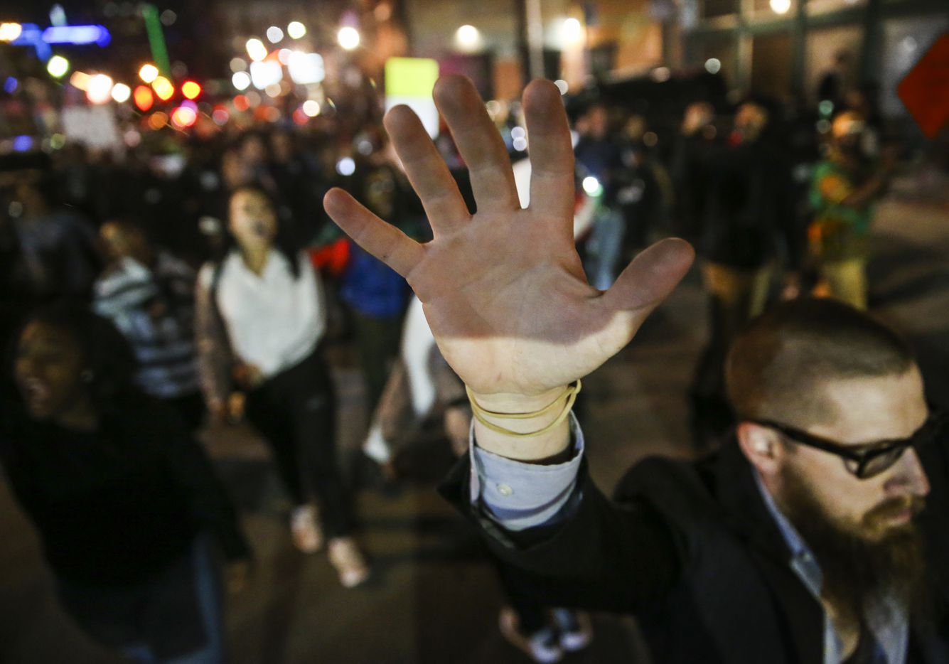 Demonstrators march through the street during a protest Saturday, March 23, 2019 in Dallas' Deep Ellum neighborhood.