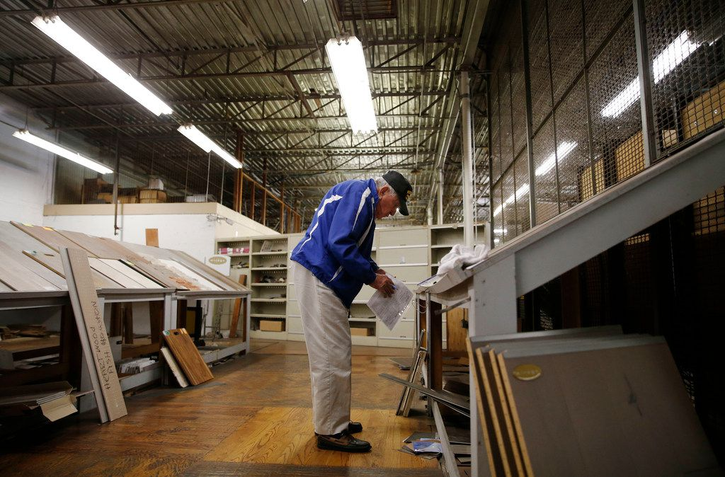Chester Hollingsworth works on inventory at S&H Distributing in Dallas.