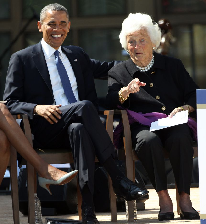 Barbara Bush visits with President Barack Obama during ceremonies for the dedication of the George W. Bush Presidential Center in University Park on April 25, 2013.