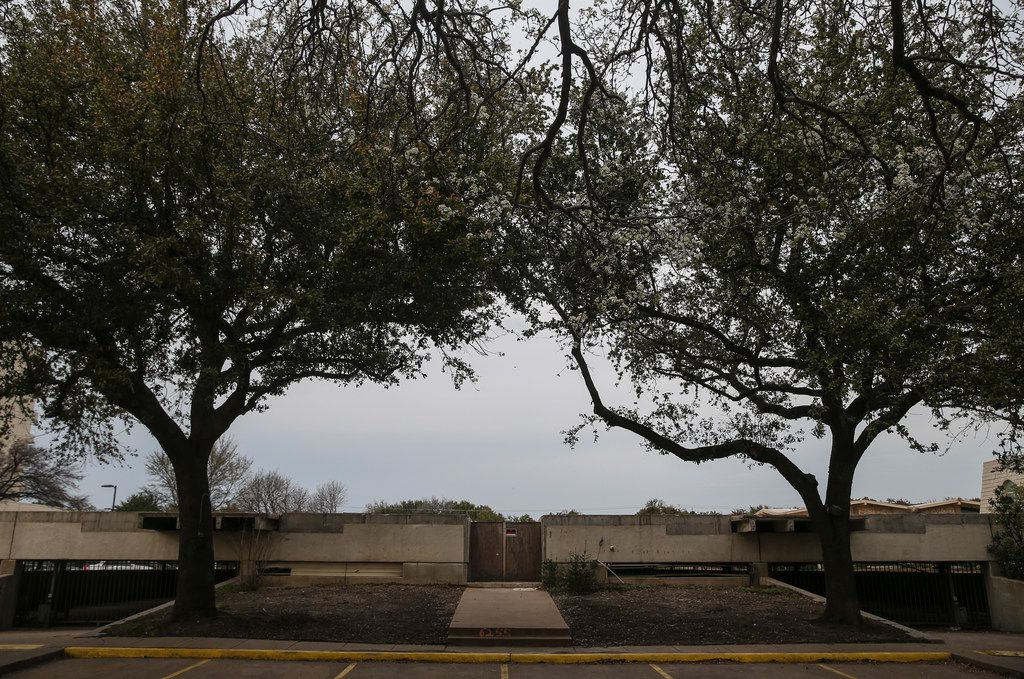 A concrete slab, all that remains of Preston Place Condominiums, which was destroyed by a fire, is seen in at 6225 West Northwest Highway on Friday, March 8, 2019, in Dallas.