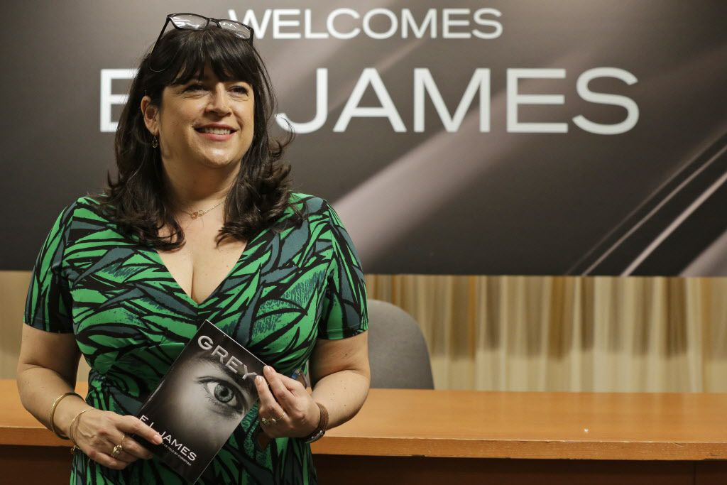 """Author EL James poses for photographers before signing her new book, """"Grey,"""" at a Barnes and Noble bookstore in New York, Thursday, June 18, 2015."""