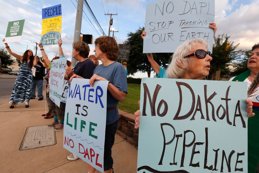 Mavis Belisle (right) joins other protesters during a National Day of Action against the Dakota Access  Pipeline to call for the Obama administration to revoke the permits for the pipeline, on the corner of Preston and Forest Lane in Dallas, TX Sept. 13, 2016.