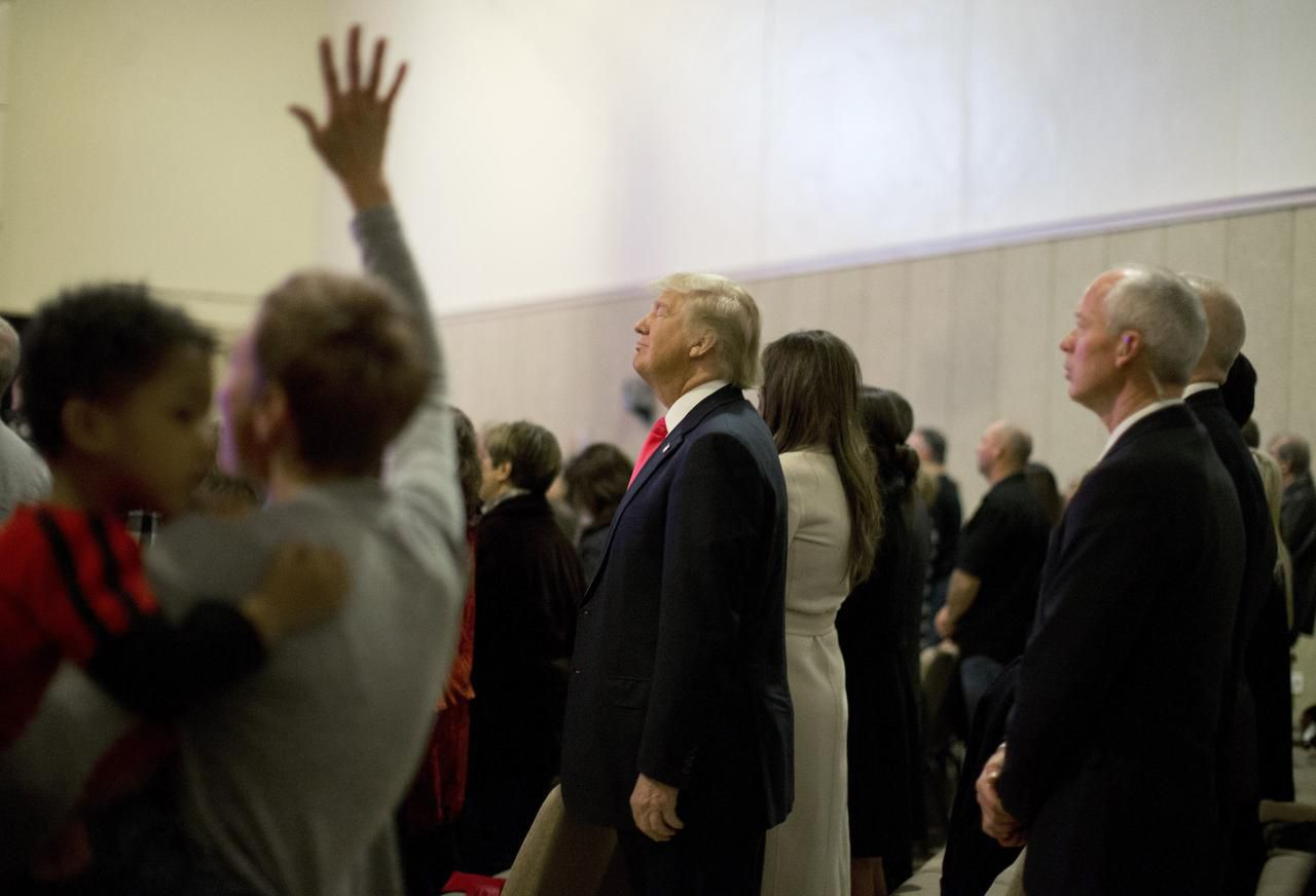 Donald Trump attended a Sunday service with his wife at First Christian Church in Council Bluffs, Iowa. He leads in the polls, but his supporters include Iowans who don't typically go to caucuses.