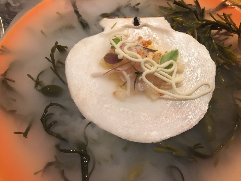 Scallop crudo with pineapple, chipotle buckwheat groats and coconut, as it was served one night on the tasting menu