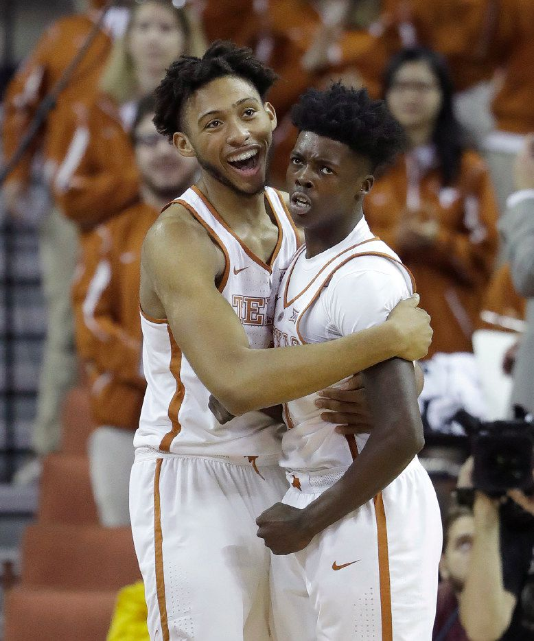 Texas center James Banks (4) celebrates a sore by guard Andrew Jones, right, during the first half of the team's NCAA college basketball game against Kent State, Tuesday, Dec. 27, 2016, in Austin, Texas. (AP Photo/Eric Gay)
