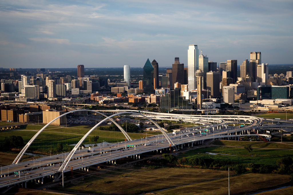 Downtown Dallas and the Margaret McDermott Bridge are shown on July 27, 2017.
