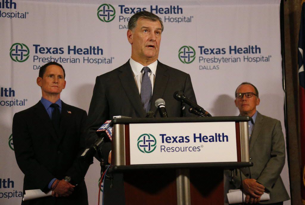 Dallas Mayor Mike Rawlings offers an assuring word as news reports of another Ebola victim surfaces, during a press conference at Texas Health Presbyterian Hospital Dallas on Sunday, October 12, 2014.  (Louis DeLuca/The Dallas Morning News)