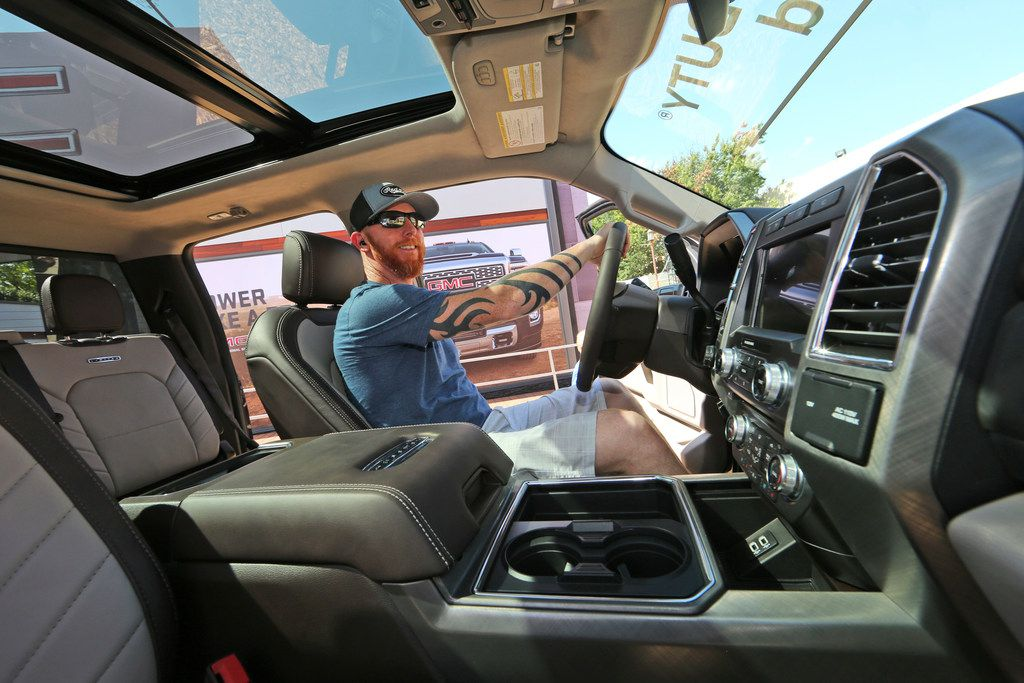 A fairgoer examines the interior of a fully-loaded F-450 Super Duty Limited, which is proof that America's favorite luxury vehicle is a pickup truck.