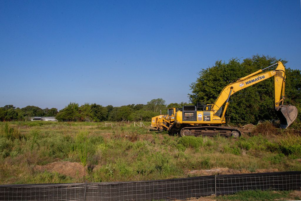 A tractor moved dirt this week on the property where Camden Homes will break ground on a single-family home development.