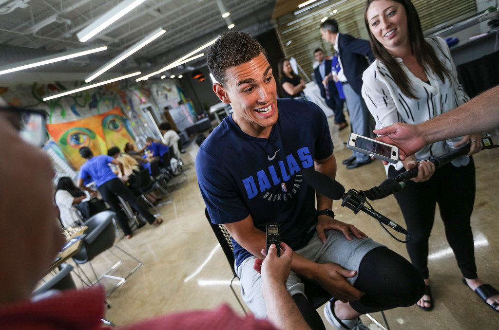 Dallas Mavericks player Dwight Powell talks members of the media as the Mavs Foundation, the nonprofit arm of the Dallas Mavericks, unveils a new Mavs Tech Center in CitySquare's newly renovated Fannie. C Harris Youth Drop In Center, to serve former foster youth ages 16-24, along with all homeless youth in the Dallas ISD, on Tuesday, June 4, 2019 in Dallas. (Ryan Michalesko/The Dallas Morning News)