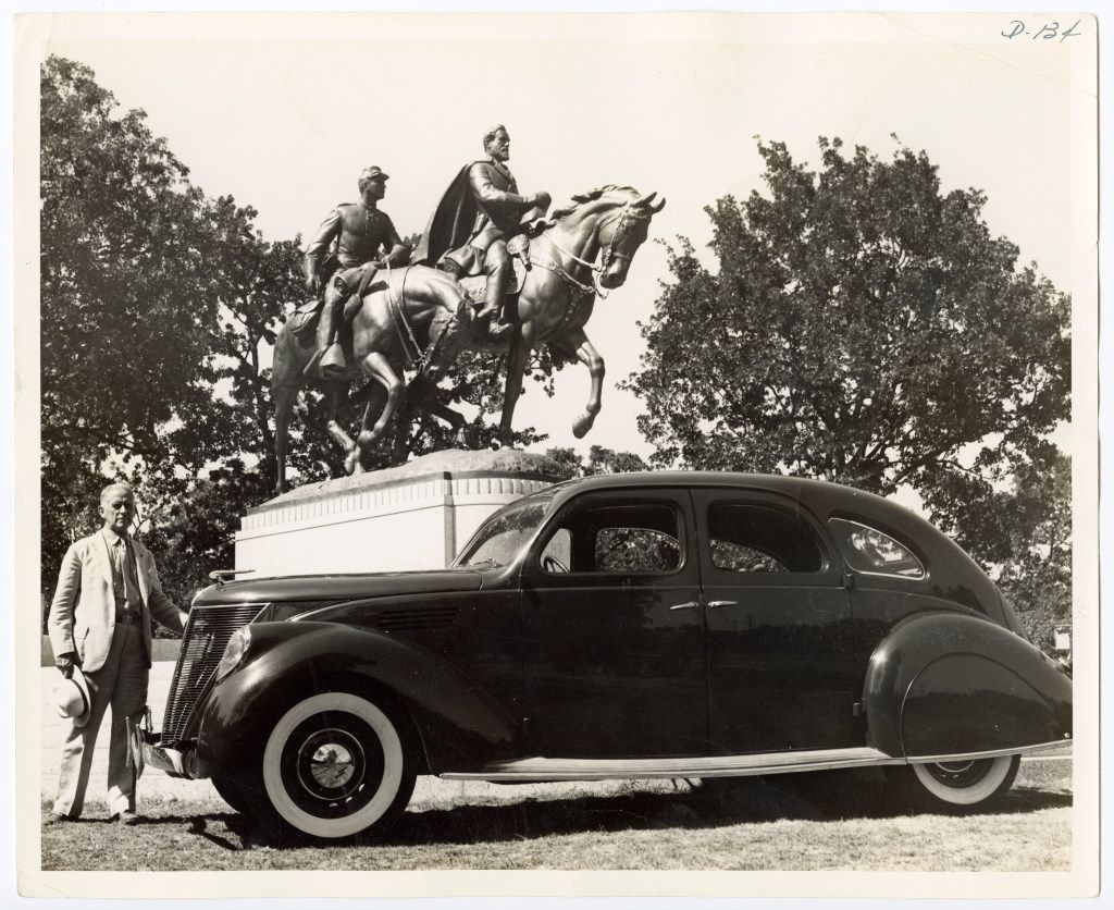 """A. Phimister Proctor, a New York sculptor who produced the equestrian statue of Robert E. Lee, is shown beside his new Lincoln-Zephyr which he has named """"Traveler"""" after the Confederate General's horse. The sculptor has more equestrian statues in this country than any other noted artist. The Dallas statue was unveiled June 12, 1936 by President Franklin D. Roosevelt who also spoke at the Texas Centennial Exposition, at Fair Park, while in town that day."""