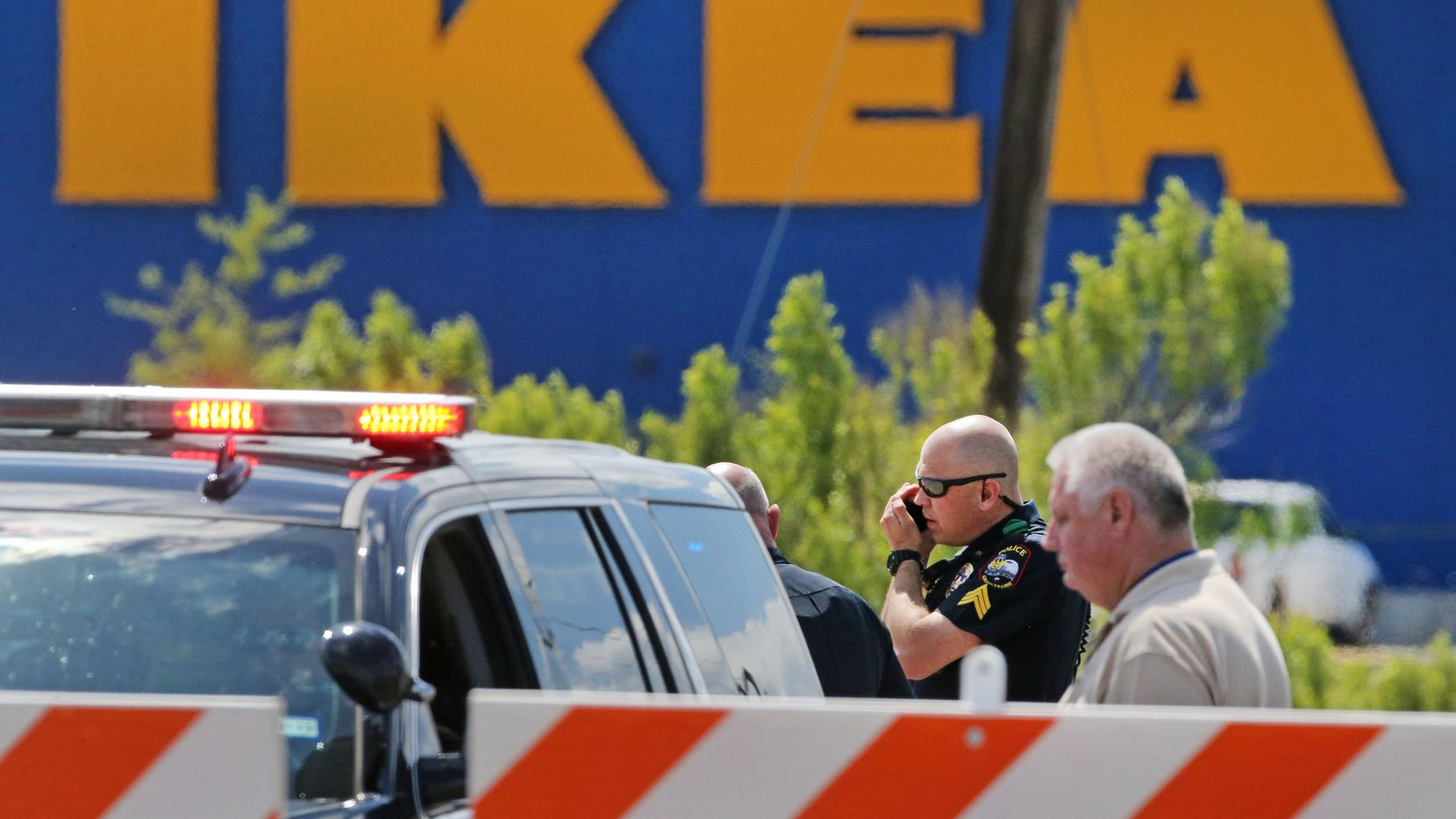 Grand Prairie police officers at the scene of a confrontation with an armed man outside the IKEA store off Mayfield and the Bush Turnpike on Monday.