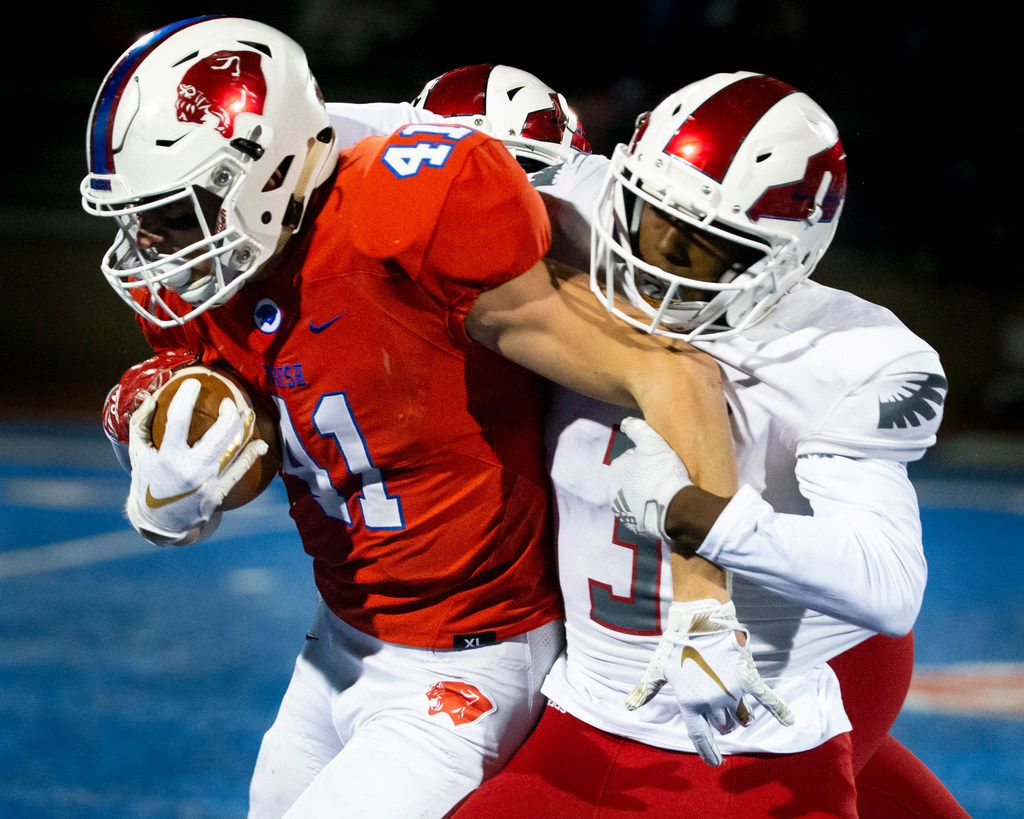 Parish Episcopal wide receiver Andrew Merrick (41) by Bishop Dunne defensive back Nicholas Johnson (3) during the football game between Parish Episcopal High School and Bishop Dunne Catholic School at the Gloria H. Snyder Stadium in Farmers Branch, Texas, on Friday, Oct. 11, 2019. (Lynda M. Gonzalez/The Dallas Morning News)