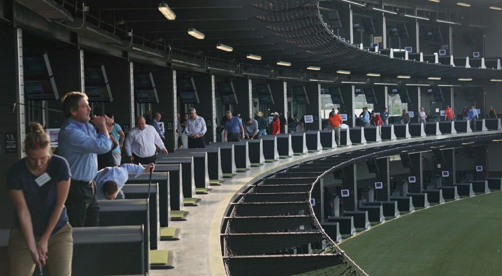 Patrons enjoy themselves at media night at the new TopGolf in Fort Worth in April.