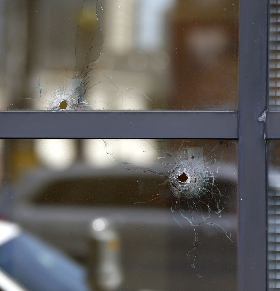 Two bullet holes are seen in the windows of El Centro College, where Micah Johnson blasted his way in before being killed by officers after a four-hour standoff.