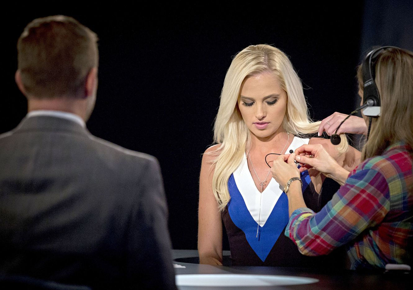 Greenville City Councilman Brent Money (left) looks on as Tomi Lahren is prepped for a taping of her show.