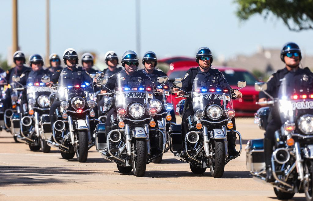 Motorcycle officers escort the body of Officer A.J. Castaneda from Grand Prairie police headquarters to The Potter's House in Dallas.