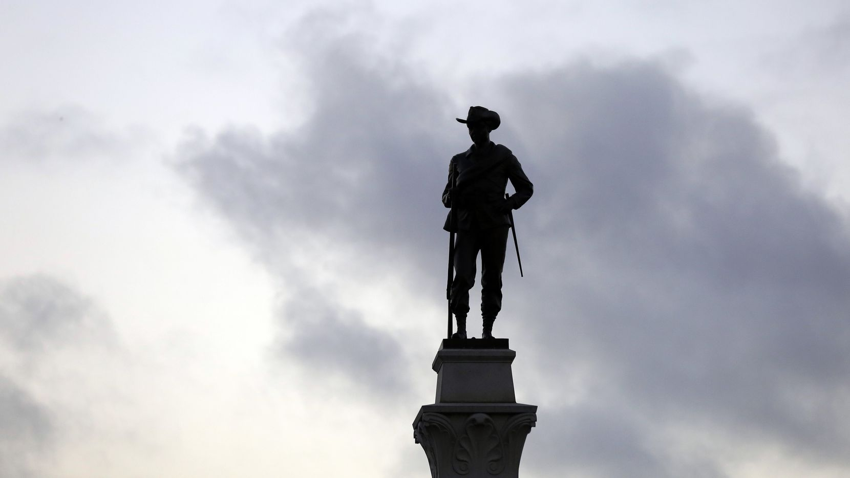A Confederate soldier statue stands tall on the Texas Brigade monument on the east side of the Capitol in Austin.