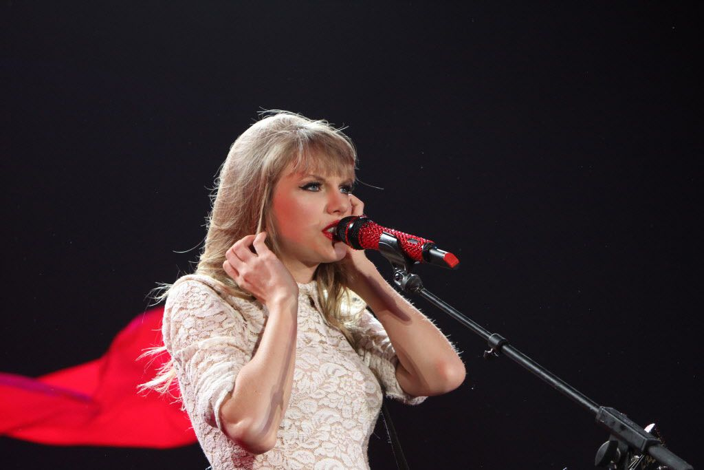 Appearing to be dressed in a cape, Taylor Swift performs to the delight of her fans in Arlington on May 25, 2013.