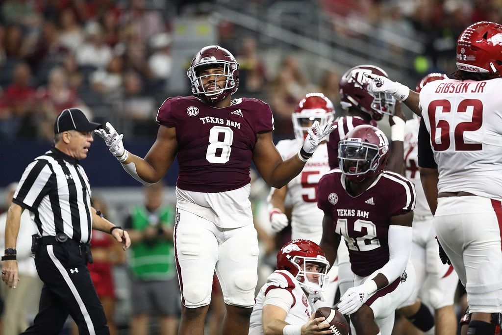 ARLINGTON, TX - SEPT. 29:  Kingsley Keke #8 of the Texas A&M Aggies reacts after a sack against Ty Storey #4 of the Arkansas Razorbacks during Southwest Classic at AT&T Stadium on Sept. 29, 2018, in Arlington.  (File photo by Ronald Martinez/Getty Images)