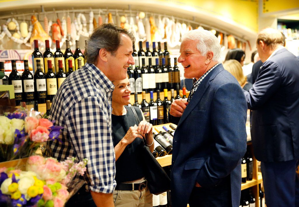 Eatzi's Market & Bakery owner Phil Romano (right) visits with guests during VIP night at the new University Park Village store in Fort Worth on May 9.