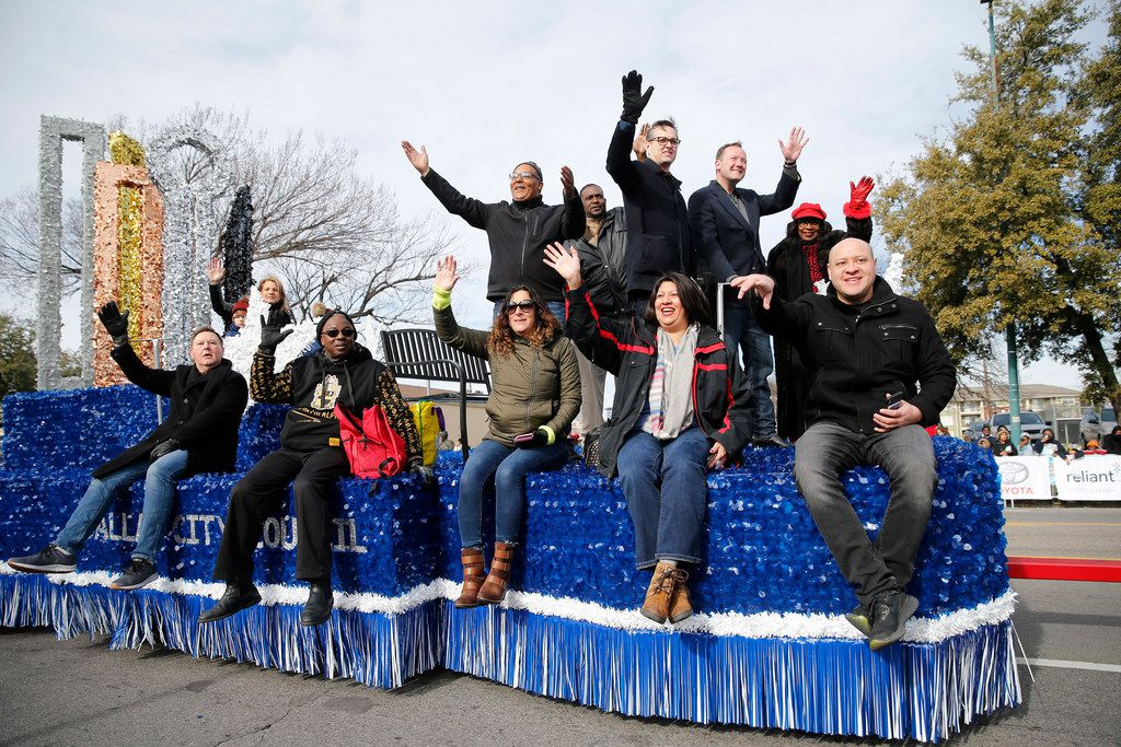 Dallas City Council members wave to people as they make their way down Martin Luther King Jr. Blvid. during the 37th Annual MLK Parade in Dallas on Saturday, January 21, 2019. (Vernon Bryant/The Dallas Morning News)