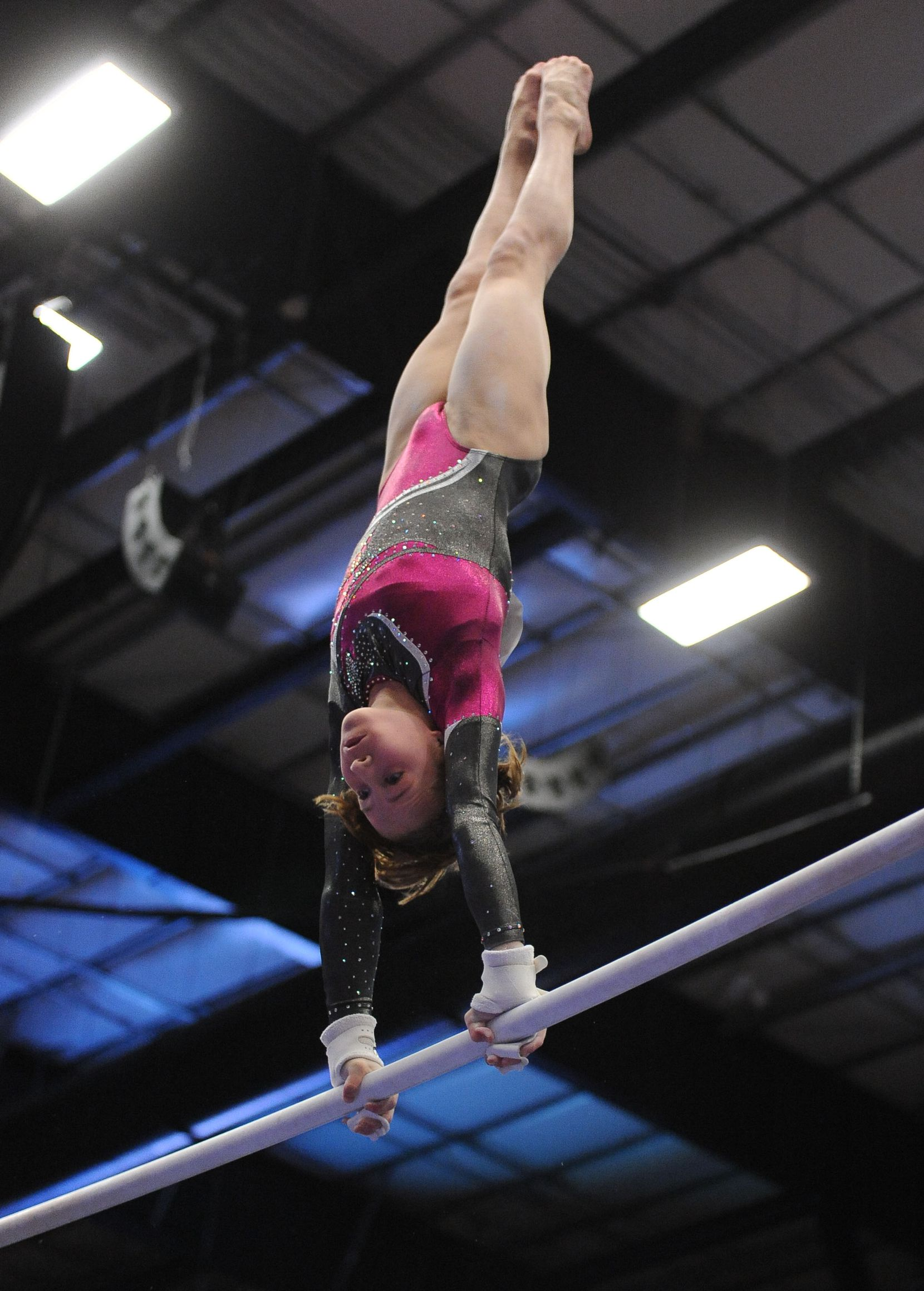 WOGA gymnast Madison Kocian competes on the bars during the competition. Gymnasts from Texas to the Ukraine competed in the WOGA Classic held at the Dr. Pepper arena in Frisco on February 18, 2012.