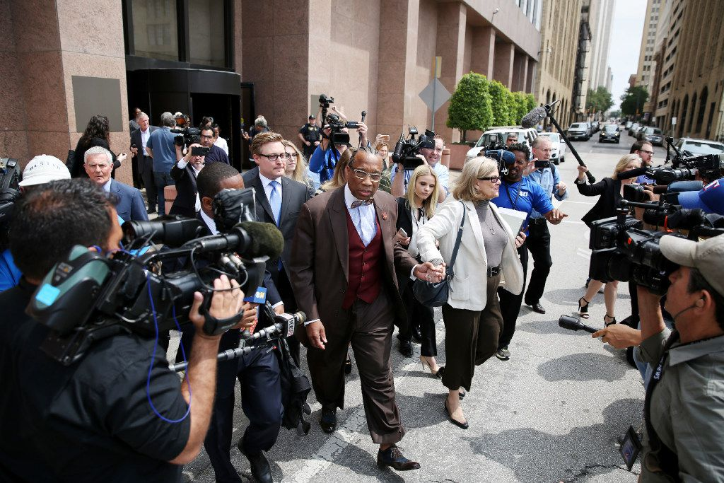 Dallas County commissioner John Wiley Price walks out of the the Earle Cabell Federal Building while holding hands with his lawyer, Shirley Baccus-Lobel, after being found not guilty of seven counts during his federal corruption trail in Dallas. (Andy Jacobsohn/The Dallas Morning News)