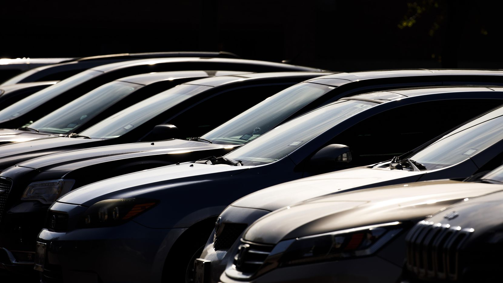 Sunlight beats down a cars parked in a parking lot in Dallas on Thursday, June 15, 2017. As temperatures rise outside the temperatures inside cars in parking lots can become dangerously, sometimes fatally, high.
