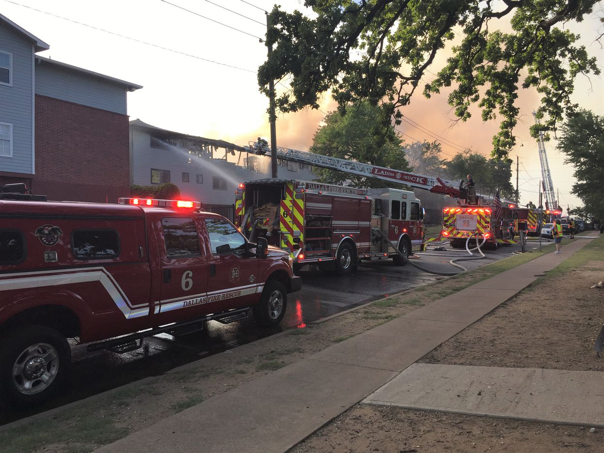 Crews on Tuesday evening battled the blaze at a north Oak Cliff apartment.