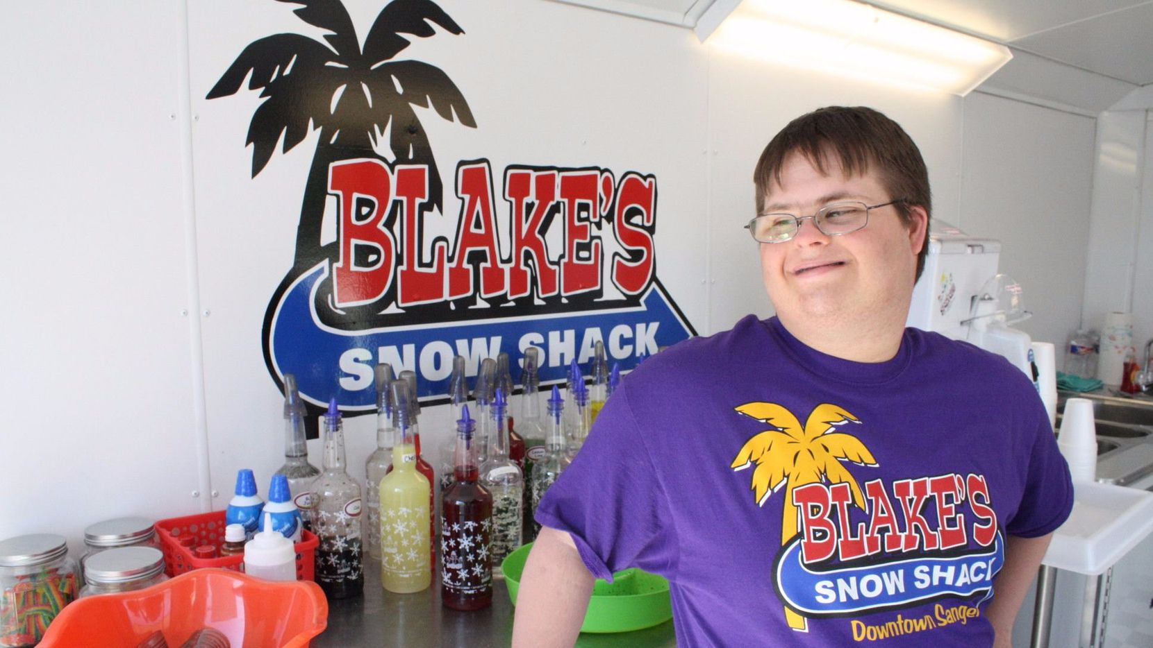 Blake Pyron stands inside his snow cone shack just days ahead of the grand opening on May 7. Pyron is the youngest business owner in Sanger, and the only one with Down Syndrome.