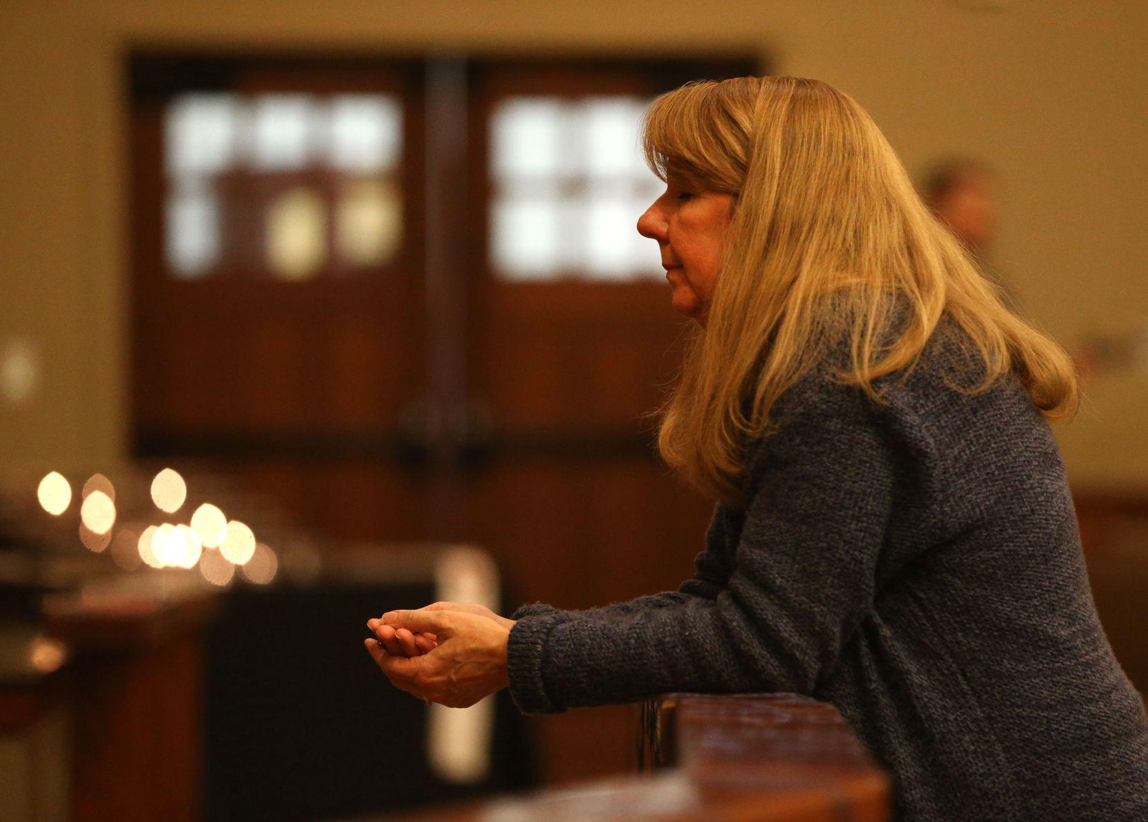 The Rev. Laura Echols-Richter prays in the sanctuary at Grace Avenue United Methodist Church in Frisco.