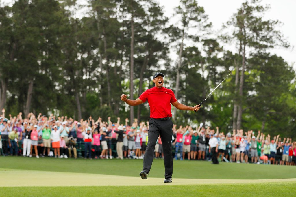 AUGUSTA, GEORGIA - APRIL 14: (Sequence frame 3 of 12) Tiger Woods of the United States celebrates after making his putt on the 18th green to win the Masters at Augusta National Golf Club on April 14, 2019 in Augusta, Georgia. (Photo by Kevin C. Cox/Getty Images)