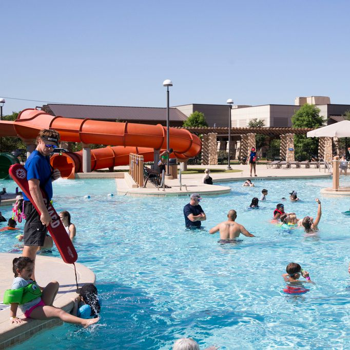 Hotel guests play in the outdoor water park section at the Great Wolf Lodge.