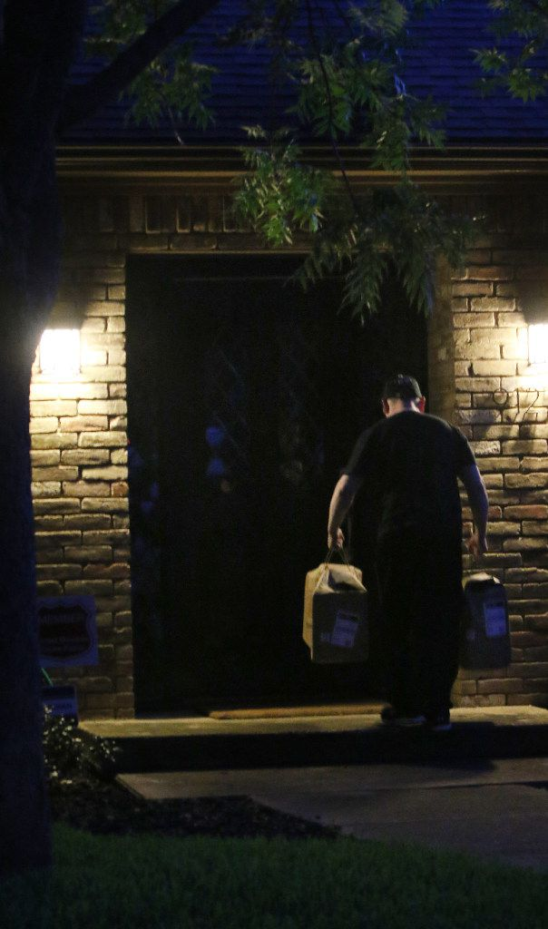 Amazon.com's Carlos Cepeda delivers groceries on Clayco Drive in the Lake Highlands area of Dallas early morning on June 21.