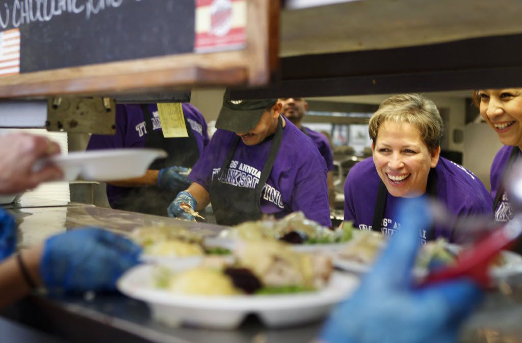 Volunteers (from left) Cirilo Rodriguez, Omega Martinez and Ana Barron help serve free Thanksgiving dinners at Norma's Cafe in the Oak Cliff neighborhood of Dallas on Thursday, Nov. 27, 2014. (Jim Tuttle/The Dallas Morning News)