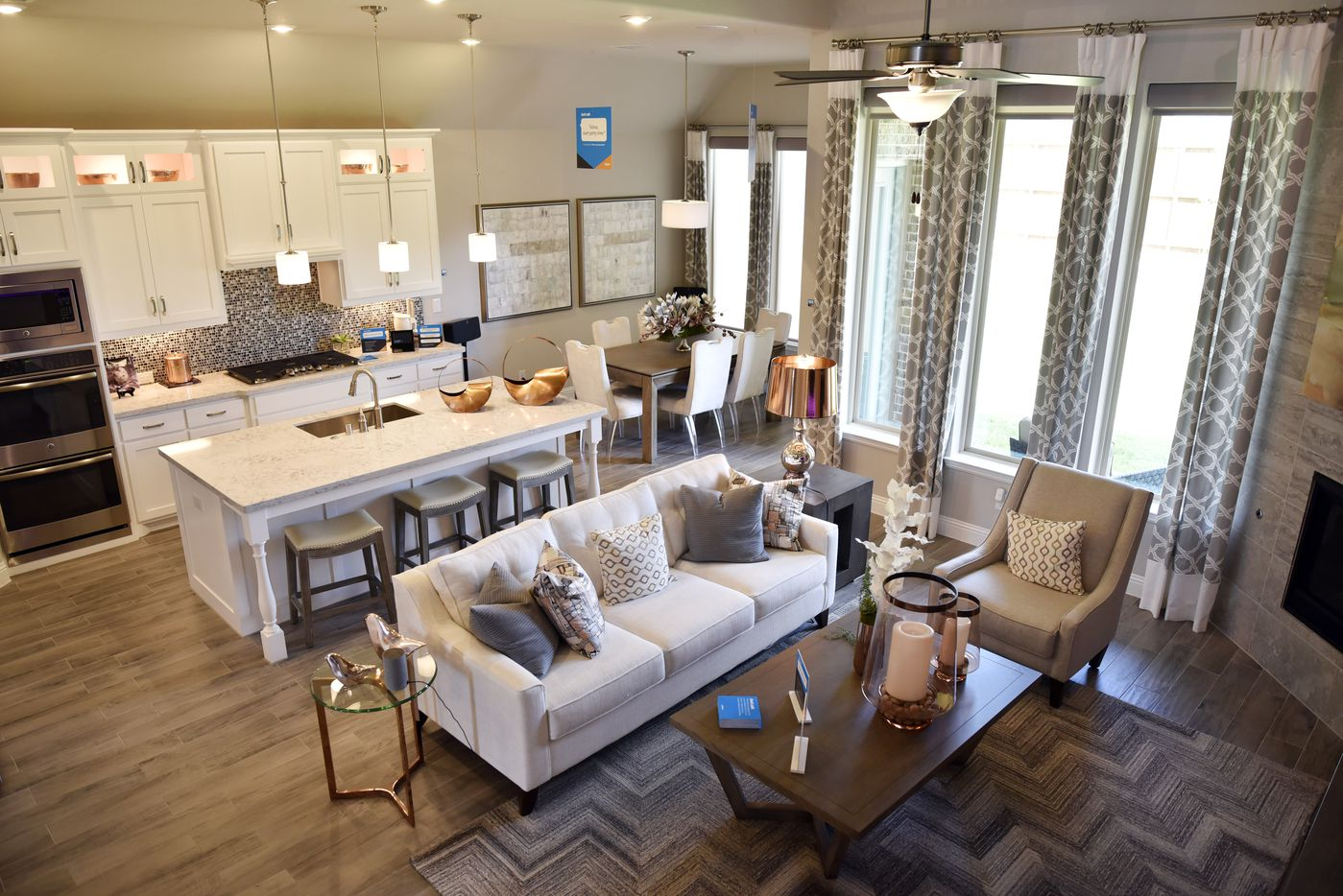 The living room and kitchen inside a Lennar Homes model house sits behind the separate living suite.